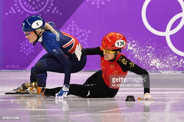 TOPSHOT Britain's Elise Christie and China's Li Jinyu crash in the women's 1500m short track speed skating semifinal event during the Pyeongchang...