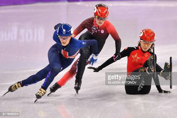 TOPSHOT Britain's Elise Christie Canada's Kim Boutin and China's Qu Chunyu compete in the women's 500m short track speed skating semifinal event...
