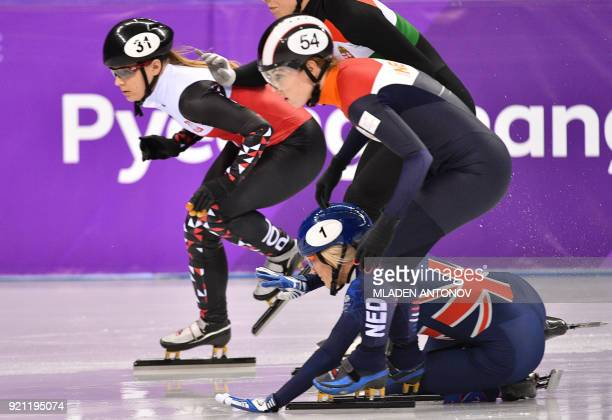 TOPSHOT Britain's Elise Christie falls during the women's 1000m short track speed skating heat event during the Pyeongchang 2018 Winter Olympic Games...