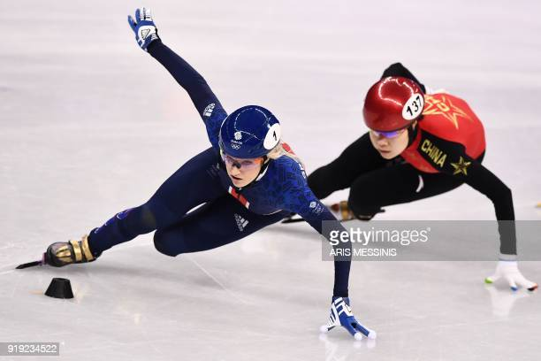 Britain's Elise Christie leads China's Zhou Yang in the women's 1,500m short track speed skating heat event during the Pyeongchang 2018 Winter...