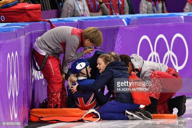 TOPSHOT Britain's Elise Christie receives medical attention after a crash in the women's 1500m short track speed skating semifinal event during the...