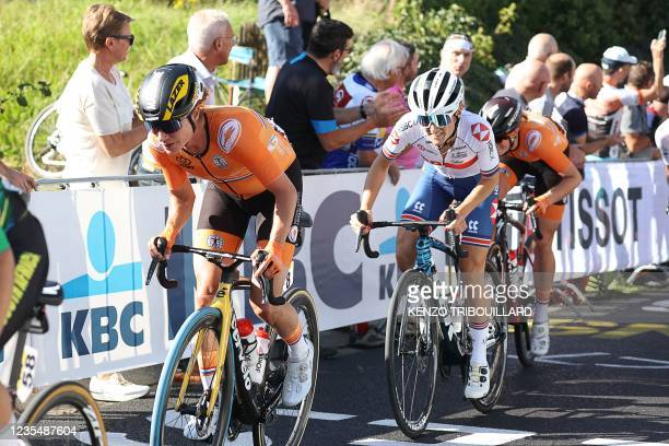 Britain's Elizabeth Deignan and Netherlands' Marianne Vos ride in the pack the women's elite cycling road race 7km from Antwerp to Leuven, on the...
