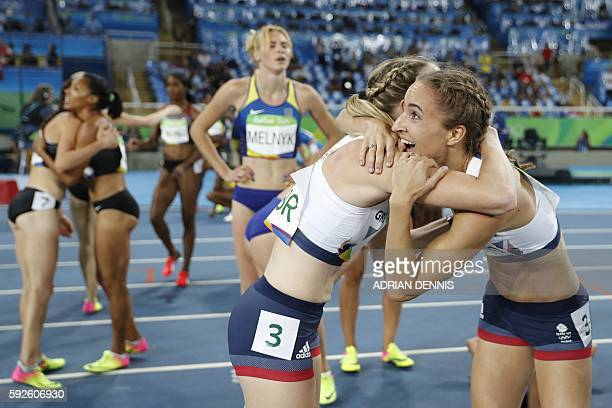Britain's Emily Diamond and Eilidh Doyle celebrate winning the bronze medal in the Women's 4x400m Relay Final during the athletics event at the Rio...