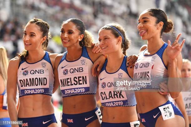 Britain's Emily Diamond Britain's Laviai Nielsen Britain's Zoey Clark and Britain's Jodie Williams pose after the Women's 4x400m Relay final at the...