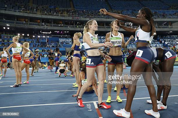 Britain's Emily Diamond Eilidh Doyle Anyika Onuora and Christine Ohurougu celebrate winning the bronze medal in the Women's 4x400m Relay Final during...