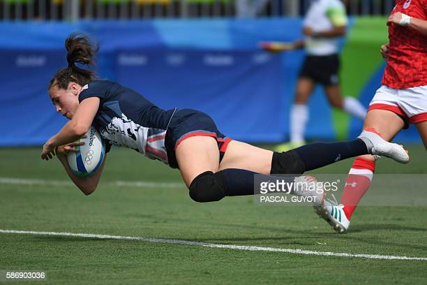 Britain's Emily Scarratt scores a try in the womens rugby sevens match between Canada and Britain during the Rio 2016 Olympic Games at Deodoro...