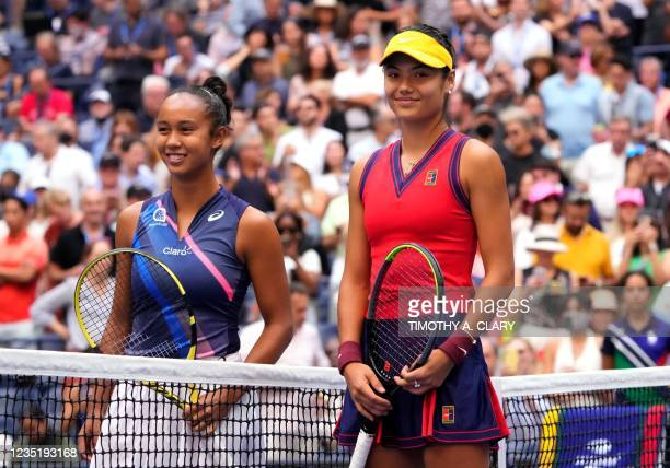 Britain's Emma Raducanu and Canada's Leylah Fernandez pose at the net ahead of their 2021 US Open Tennis tournament women's final match at the USTA...