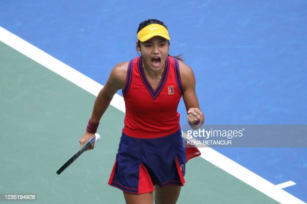 Britain's Emma Raducanu celebrates after scoring a point against Canada's Leylah Fernandez during their 2021 US Open Tennis tournament women's final...