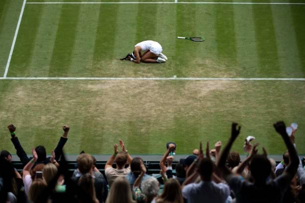 Britain's Emma Raducanu celebrates winning against Romania's Sorana Cirstea during their women's singles third round match on the sixth day of the...
