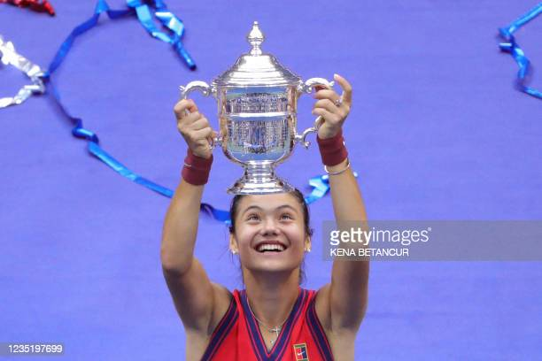 Britain's Emma Raducanu celebrates with the trophy after winning the 2021 US Open Tennis tournament women's final match against Canada's Leylah...