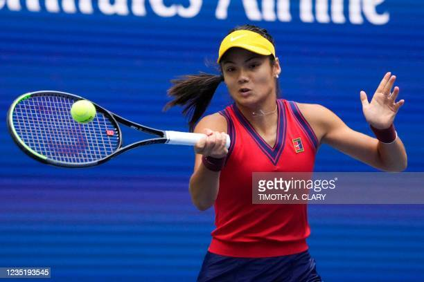 Britain's Emma Raducanu hits a return to Canada's Leylah Fernandez during their 2021 US Open Tennis tournament women's final match at the USTA Billie...