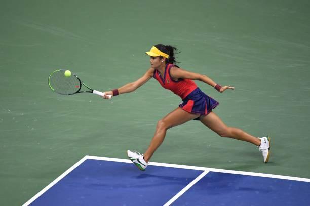 Britain's Emma Raducanu hits a return to Greece's Maria Sakkari during their 2021 US Open Tennis tournament women's semifinal match at the USTA...