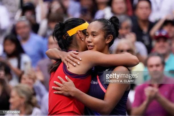 Britain's Emma Raducanu hugs Canada's Leylah Fernandez after winning their 2021 US Open Tennis tournament women's final match at the USTA Billie Jean...