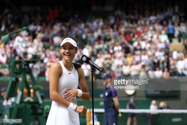 Britain's Emma Raducanu reacts as she gives a media interview after winning against Romania's Sorana Cirstea during their women's singles third round...