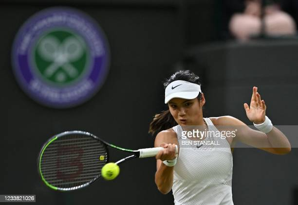 Britain's Emma Raducanu returns against Australia's Ajla Tomljanovic during their women's singles fourth round match on the seventh day of the 2021...