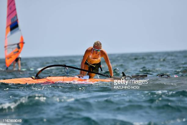 Britain's Emma Wilson participates in the women's windsurfing RSX class competition during a sailing test event for the Tokyo 2020 Olympic Games off...