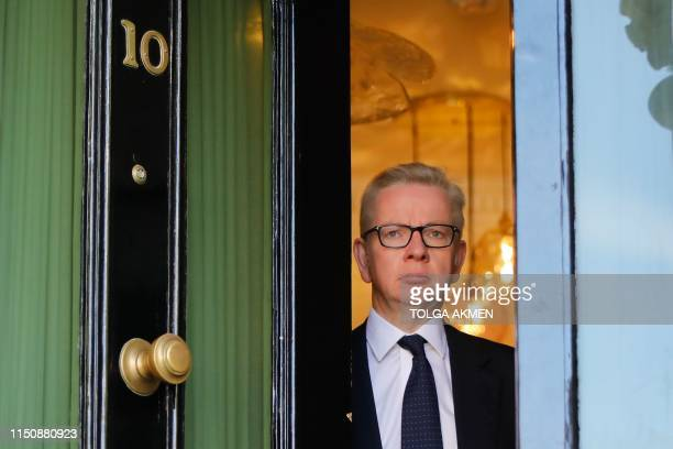 Britain's Environment Food and Rural Affairs Secretary and Conservative leadership contender Michael Gove leaves his home in London on June 20 2019...