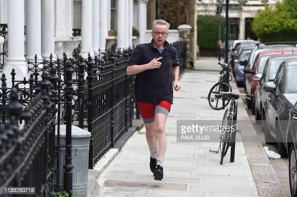 TOPSHOT Britain's Environment Food and Rural Affairs Secretary Michael Gove goes on a morning job in west London on March 28 2019