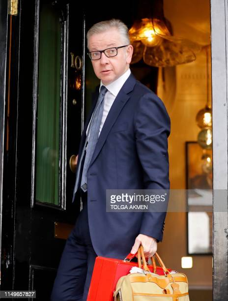 Britain's Environment Food and Rural Affairs Secretary Michael Gove leaves his residence in London on June 13 2019 The 10 candidates running to...