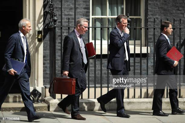 Britain's Environment Food and Rural Affairs Secretary Michael Gove Britain's Attorney General Jeremy Wright and Britain's Northern Ireland Secretary...