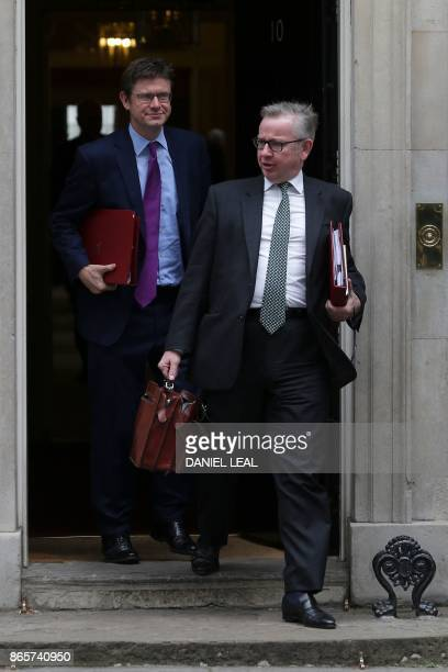 Britain's Environment Food and Rural Affairs Secretary Michael Gove and Britain's Business Energy and Industrial Strategy Secretary Greg Clark leave...