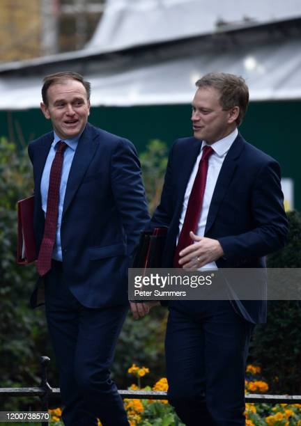 Britain's Environment Secretary George Eustice and Britain's Transport Secretary Grant Shapps arrive for the first meeting of the cabinet following...
