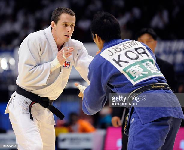 Britain's Euan Burton fights with South Korea's Kim JaeBum in the men's 81kg class final match at the Grand Slam Tokyo judo tournament at Tokyo...