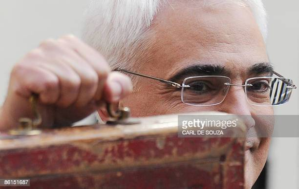 Britain's Finance Minister Alistair Darling poses for pictures with a briefcase containing the 2009 Budget Report at a photocall outside 11 Downing...