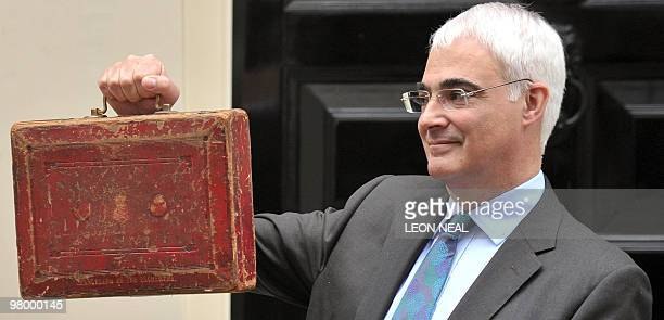 Britain's Finance Minister Alistair Darling poses for pictures with a briefcase containing the 2010 Budget Report at a photocall outside 11 Downing...