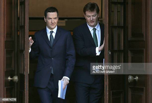 Britain's Finance Minister George Osborne and the Chief Secretary to the Treasury Danny Alexander leave the Treasury for the House of Commons to...