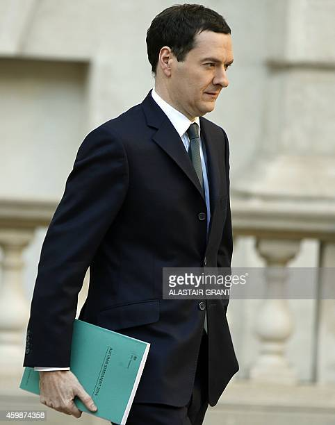 Britain's Finance Minister George Osborne leaves the Treasury for the House of Commons to deliver the Autumn statement in central London on December...