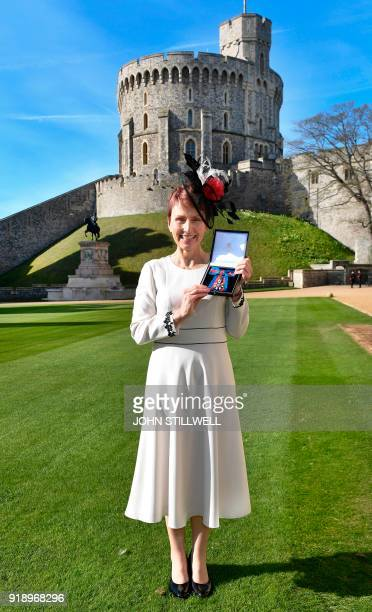 Britain's first astronaut Helen Sharman holds her Companion of the Order of St Michael and St George medal presented by Queen Elizabeth II for...