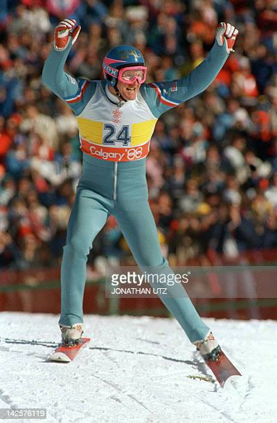 Britain's first ever Olympic ski jumper Eddie Edwards waves to the cheering crowd after completing his first safe jump during the 90m event 23...