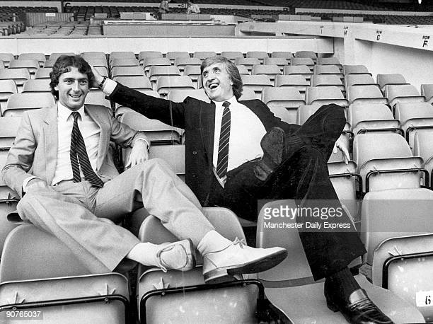 Britains first million pound footballer Trevor Francis sits in the stands with manager John Bond after signing for Manchester City FC Francis began...