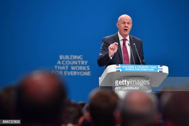 Britain's First Secretary of State and Minister for the Cabinet Office Damian Green addresses the delegates on the first day of the Conservative...