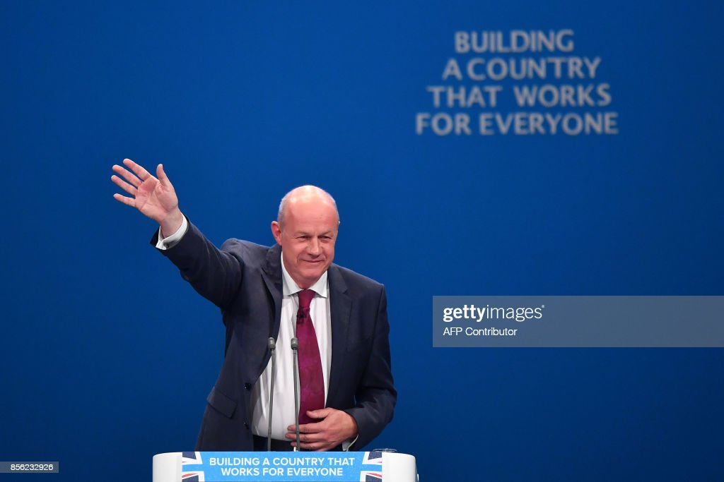 Britain's First Secretary of State and Minister for the Cabinet Office, Damian Green gestures after adressing the delegates on the first day of the Conservative Party annual conference at the Manchester Central Convention Centre, in Manchester on October 1, 2017. British Prime Minister Theresa May's Conservative Party gathers on October 1, 2017, for its annual conference, dominated by questions about her leadership and splits on Brexit. / AFP PHOTO / Ben STANSALL