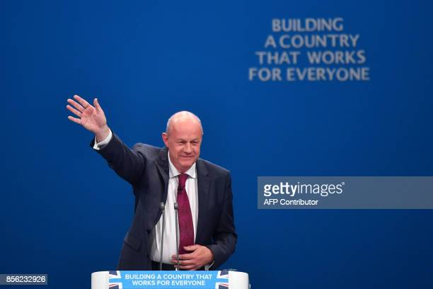 Britain's First Secretary of State and Minister for the Cabinet Office Damian Green gestures after adressing the delegates on the first day of the...