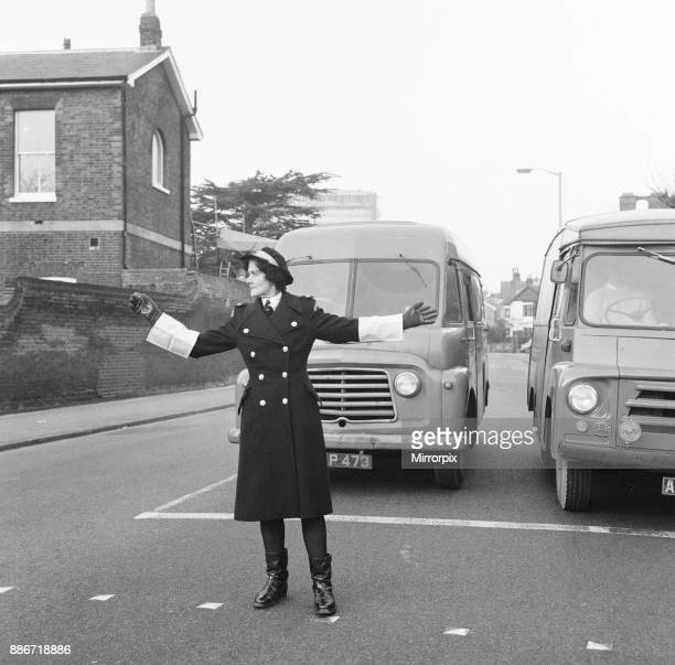 Britain's first Traffic Warden to control traffic as opposed to booking cars for parking offences Mrs Joyce Roffey on point duty at a busy crossroads...