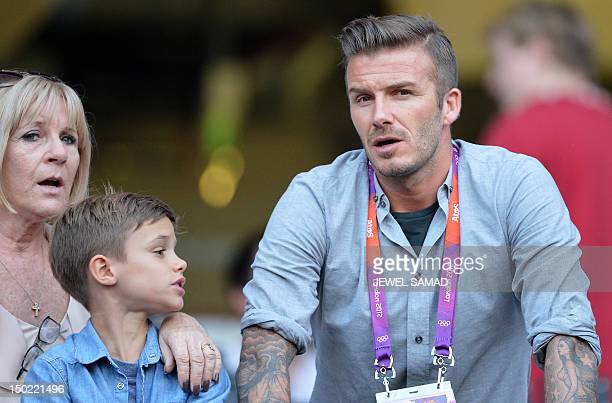 Britain's footballer David Beckham looks on ahead the Olympic stadium during the closing ceremony of the 2012 London Olympic Games in London on...