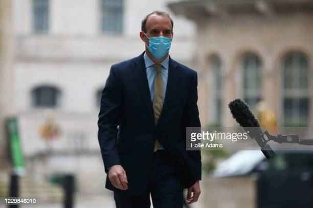 Britain's Foreign Secretary and First Secretary of State Dominic Raab wears a face mask as he arrives to appear on the Andrew Marr Show at BBC...