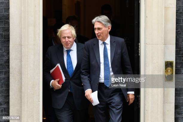 Britain's Foreign Secretary Boris Johnson and Chancellor Philip Hammond leave number 10 Downing Street following an extended Cabinet meeting on...