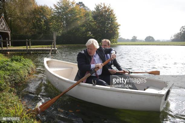 Britain's Foreign Secretary Boris Johnson and Czech Republic's Deputy Foreign Minister Ivo Sramek put out on a boating lake in row boat in the...