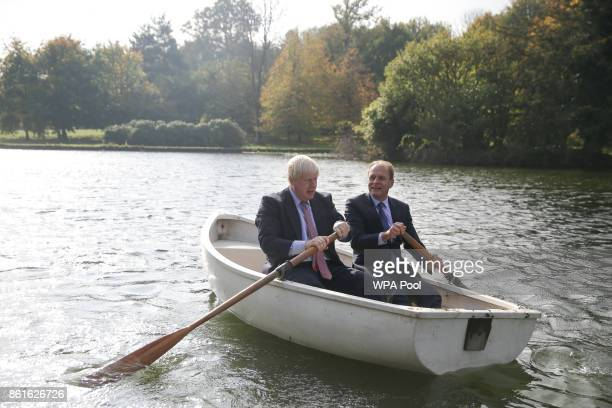 Britain's Foreign Secretary Boris Johnson and Czech Republic's Deputy Foreign Minister Ivo Sramek go out onto a boating lake in a rowing boat before...