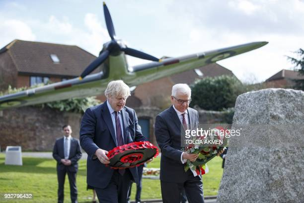 Britain's Foreign Secretary Boris Johnson and his Polish counterpart Jacek Czaputowicz lay wreaths during a visit to a Battle of Britain bunker in...