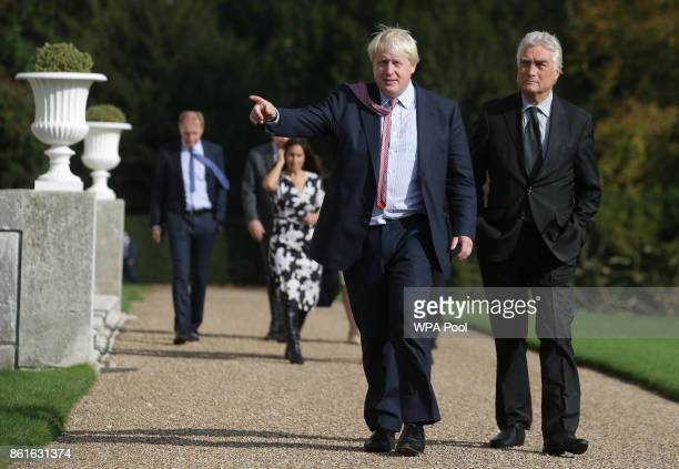 Britain's Foreign Secretary Boris Johnson and Slovenia's State Secretary Andrej Logar walk together at the British Foreign Minister's official...
