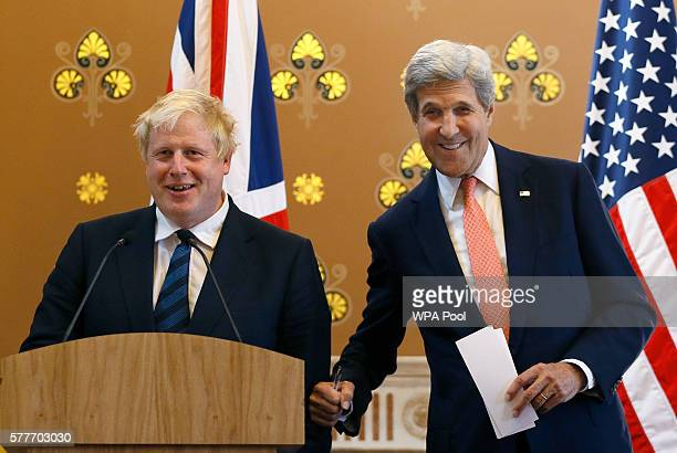 Britain's Foreign Secretary Boris Johnson and US Secretary of State John Kerry joke together during a press conference at the Foreign and...