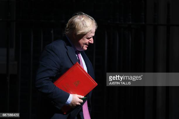 Britain's Foreign Secretary Boris Johnson arrives at Downing Street in central London on May 24 ahead of a meeting of the emergency Cobra committee...