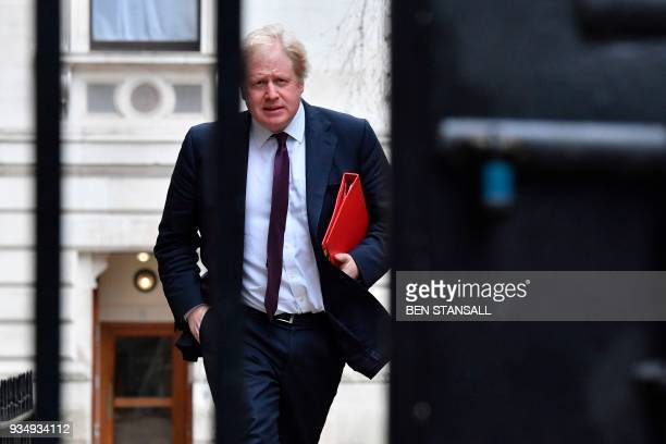 Britain's Foreign Secretary Boris Johnson arrives at Downing Street in central London on March 20 2018 for the weekly meeting of the cabinet Britain...
