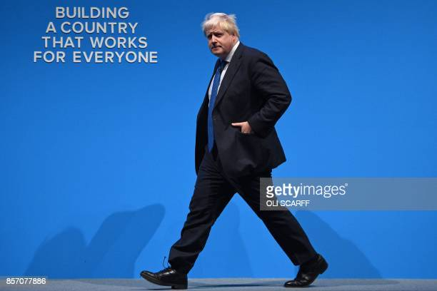 Britain's Foreign Secretary Boris Johnson arrives to deliver his speech on the third day of the Conservative Party annual conference at the...