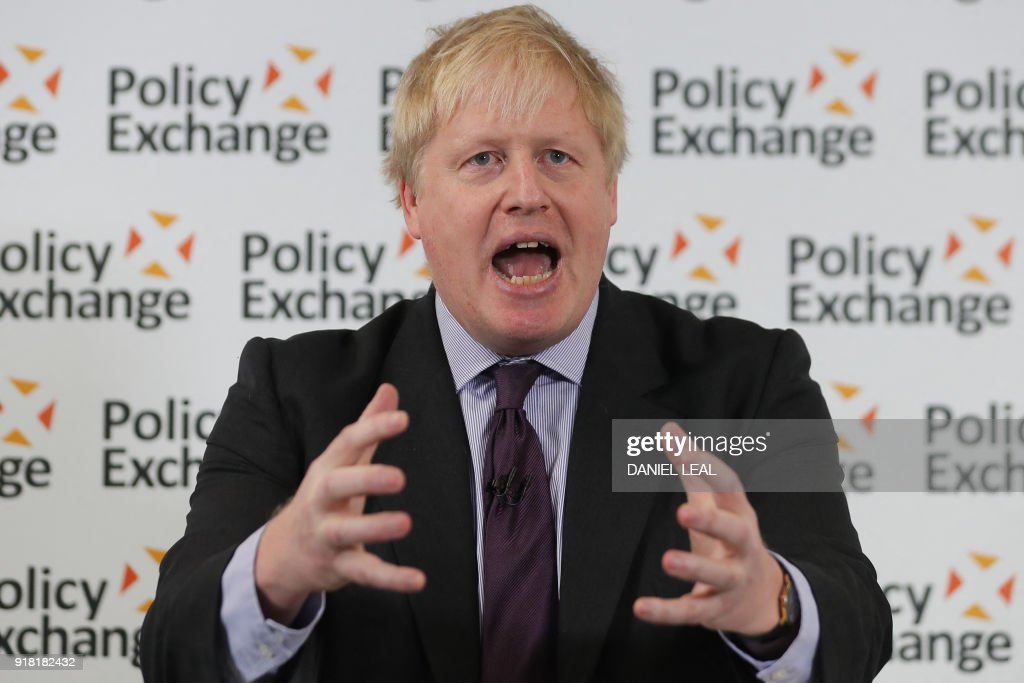 Britain's Foreign Secretary Boris Johnson delivers a speech, 'The Road to Brexit: a United Kingdom' in central London on February 14, 2018. Foreign Secretary Boris Johnson warned that Britain must throw off EU rules to reap the opportunities of Brexit -- and refused to deny he might quit if the government chose a future too closely aligned with Brussels. / AFP PHOTO / Daniel LEAL